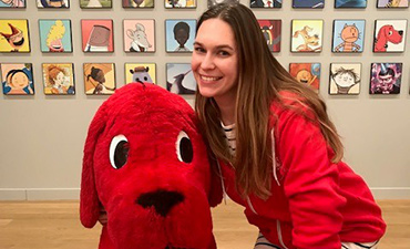 Kelsey Anderson smiles with Clifford.