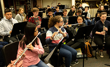 Students play instruments during a music class.