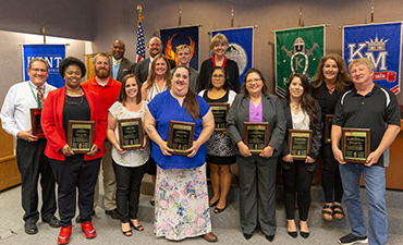Employees of the Year smile during celebration on May 22.