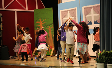 Students are dancing in the talent show.