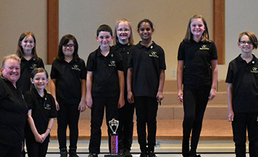 Youth choir with trophy.