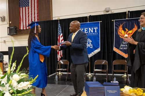 Dr. Watts with student on stage at KPA 2019 Graduation ceremony