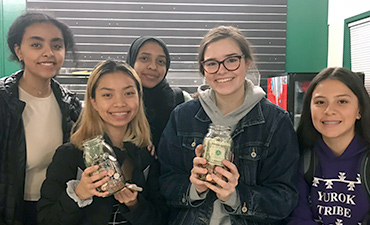 Students smile with donations.