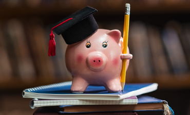 piggy bank with graduation hat
