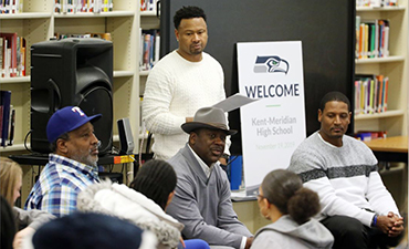 Seahawks players talking with Kent-Meridian students.