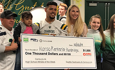 Alonso accepting check for Kentridge